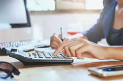 Businessman working on desk office using calculator business fin. Ancial accounting concept Stock Photography