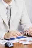 Businessman at working desk Stock Images