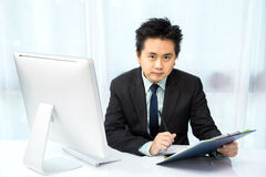 Businessman working with desktop Royalty Free Stock Image
