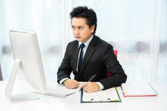 Businessman working with desktop Royalty Free Stock Images