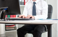 Businessman working on desktop computer Stock Photo