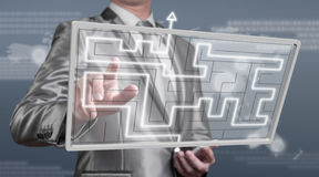 Businessman working on digital screen of maze, business strategy Stock Images