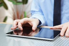 Businessman working on digital tablet, closeup Stock Photography