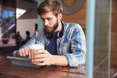 Businessman Working On Digital Tablet In Coffee Shop Stock Photos