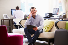Businessman Working On Digital Tablet In Hotel Lobby Stock Images