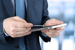 Businessman working with digital tablet outside Stock Photography