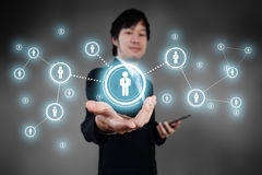 Businessman working with digital visual object, human resource c Stock Photography