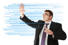 Businessman working with digits Stock Images