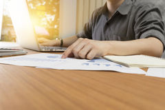 Businessman working with document on office desk Stock Photos