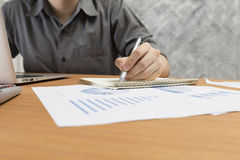 Businessman working with document on office desk Stock Photo