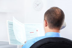 Businessman working with documents Stock Images