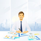 Businessman working with documents sitting at Royalty Free Stock Photos