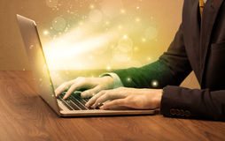 Businessman working fast on laptop royalty free stock images