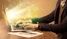 Businessman working fast on laptop stock image