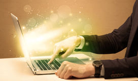 Businessman working fast on laptop royalty free stock photos