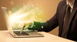 Businessman working fast on laptop royalty free stock photography