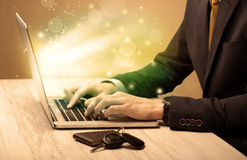 Businessman working fast on laptop stock images