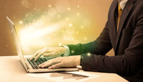 Businessman working fast on laptop stock photography