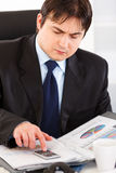 Businessman working with financial documents Stock Photos