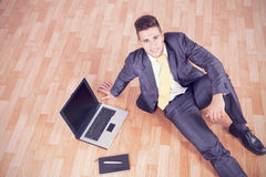 Businessman working on the floor Royalty Free Stock Photography