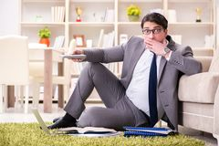 The businessman working on the floor at home stock images