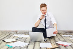Businessman Working on Floor in Office Stock Images