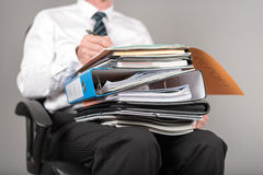 Businessman working with folders on his knees Stock Image