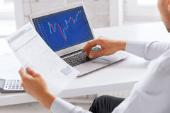 Businessman working with forex chart in office Stock Images