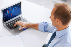 Businessman working with forex chart in office Royalty Free Stock Photo