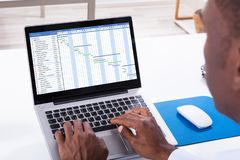 Businessman Working With Gantt Chart On Laptop royalty free stock photography