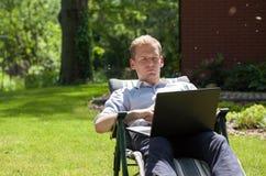 Businessman working in garden Royalty Free Stock Photo
