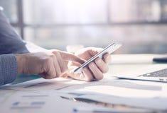 Businessman working generic design laptop. Touching screen smartphone. Horizontal mockup. Royalty Free Stock Photography