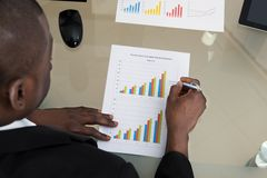 Businessman Working With Graph At Desk Royalty Free Stock Image