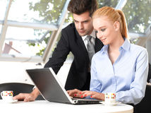 Businessman working with his colleague Royalty Free Stock Photo