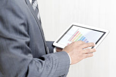 Businessman working on his digital tablet Stock Images