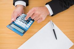 Businessman working on his finances at his desk Royalty Free Stock Photography
