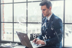 Businessman working on his laptop keyboarding net-book Royalty Free Stock Photography