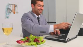 Businessman working on his laptop at lunch time Stock Photo