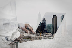 Businessman working on his laptop in office. Double exposure of businessman working on his laptop in office with london city background Royalty Free Stock Photo