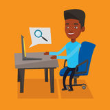 Businessman working on his laptop. Young african-american young businessman working on his laptop in office and searching information on internet. Internet Royalty Free Stock Photography