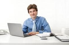 Businessman working in his office Stock Photos