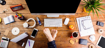 Businessman working in his office with feet on desk Royalty Free Stock Photo