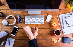 Businessman working in his office with feet on desk Royalty Free Stock Photos
