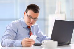 Businessman working in his office Stock Images