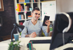 Businessman working in his office. Using digital tablet Royalty Free Stock Image
