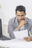 Businessman working on his paperwork in the office Royalty Free Stock Images
