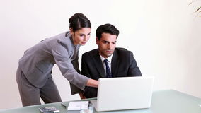Businessman working with his secretary. In his office stock footage