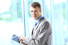 Businessman working on his tablet Royalty Free Stock Photos