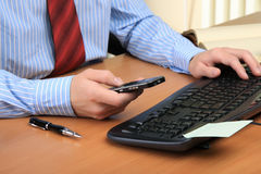 Businessman working at his workplace. Stock Photos