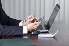 Businessman working and holding smart phone Royalty Free Stock Images